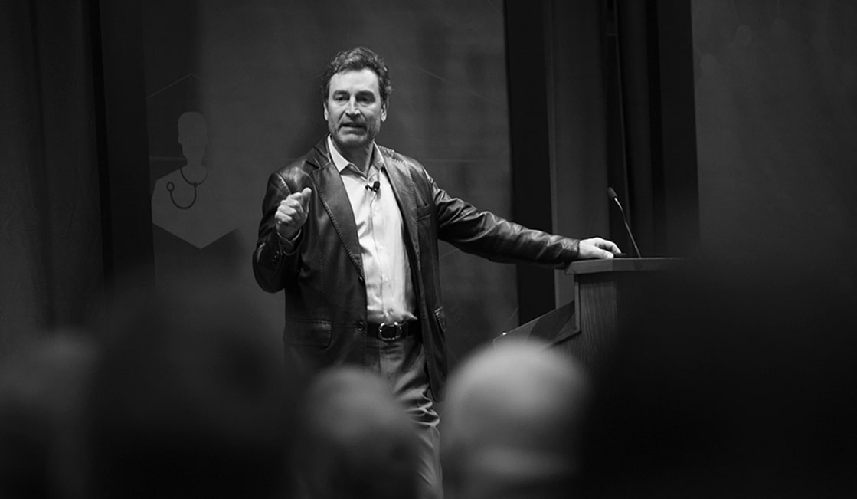 Ken Schmidt speaking at an event